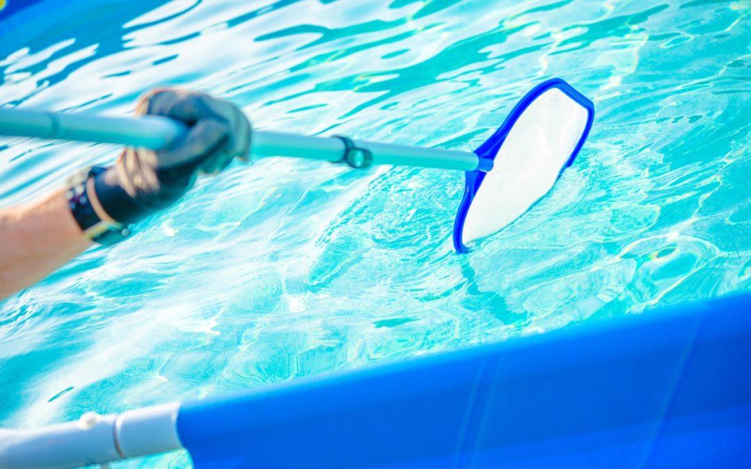 Backyard Garden Swimming Pool Cleaning Closeup. Taking Care of Pool.